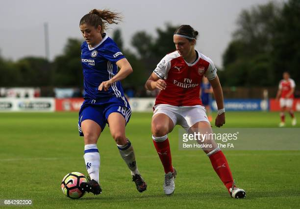 Maren Mjelde of Chelsea controls the ball ahead of Lotte WubbenMoy of Arsenal during the WSL 1 match between Chelsea Ladies and Arsenal Ladies on May...