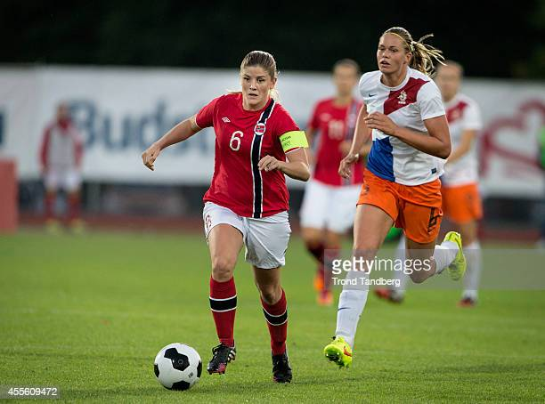 Maren Mjelde of Norway and Anouk Dekker of the Netherlands in action during the FIFA Women's World cup qualifier match between Norway and the...