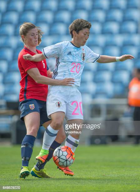 Maren Mjelde of Norway and Kumi Yokoyama of Japan during the Group B 2017 Algarve Cup match between Norway and Japan at the Estadio Algarve on March...