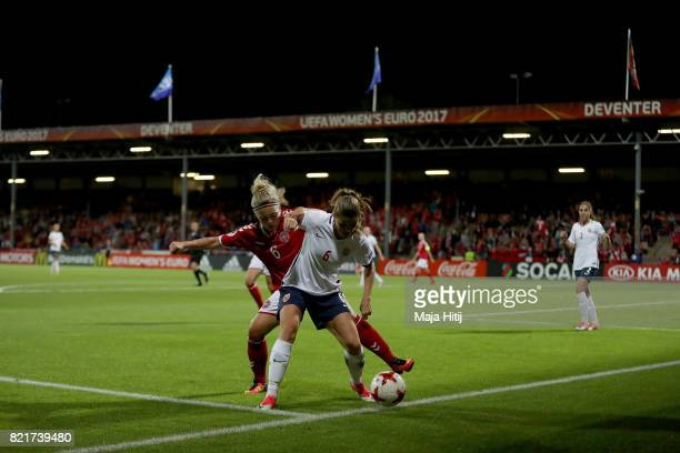 Maren Mjelde of Norway and Nanna Christiansen of Denmark compete for the ball during the Group A match between Norway and Denmark during the UEFA...