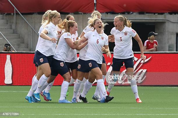 Maren Mjelde of Norway celebrates her goal on a direct kick with team mates during the FIFA Women's World Cup Canada 2015 Group B match between...