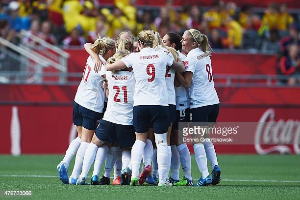 Maren Mjelde of Norway celebrates with team mates as she scores their first goal during the FIFA Women's World Cup Canada 2015 Group B match between...