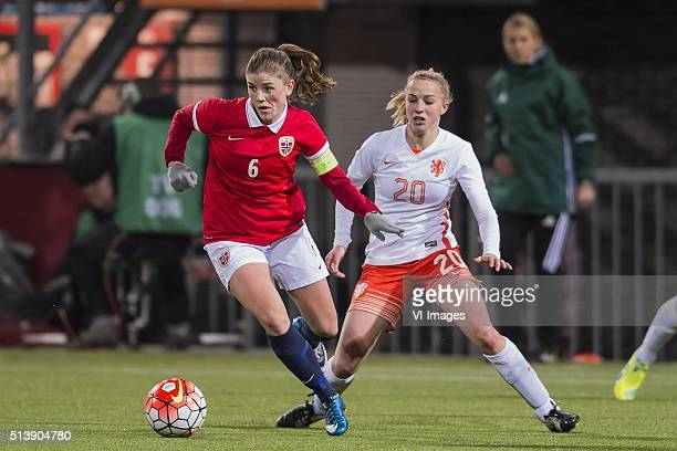 Maren Mjelde of Norway Jacky Groenen of the Netherlands during the 2016 UEFA Women's Olympic Qualifying Tournament match between Norway and...