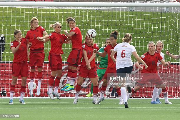 Maren Mjelde of Norway scores a goal on a direct kick as Annike Krahn Saskia Bartusiak Lena Goessling Dzsenifer Marozsan Tabea Kemme Celia Sasic and...