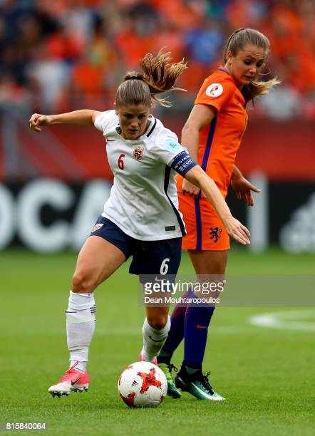 Maren Mjelde of Norway tackles with Lieke Martens of the Netherlands during the Group A match between Netherlands and Norway during the UEFA Women's...