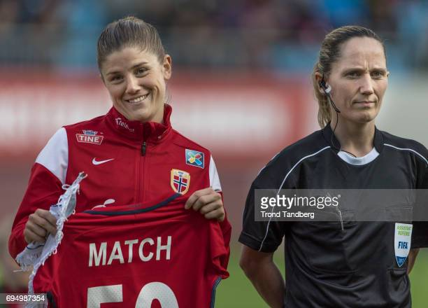 Maren Mjelde with Match Shirt 50 of Norway Referee Amy Fearn of Great Britain before during International Friendly between Norway Woman v USA Women...