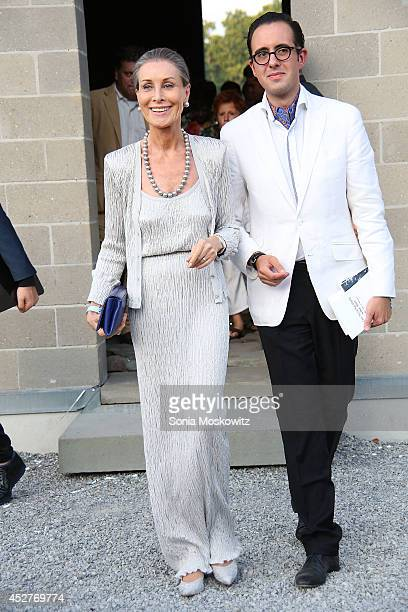 Maren Otto and Jose Macian attend the 21st Annual Watermill Summer Benefit at The Watermill Center on July 26 2014 in Water Mill New York