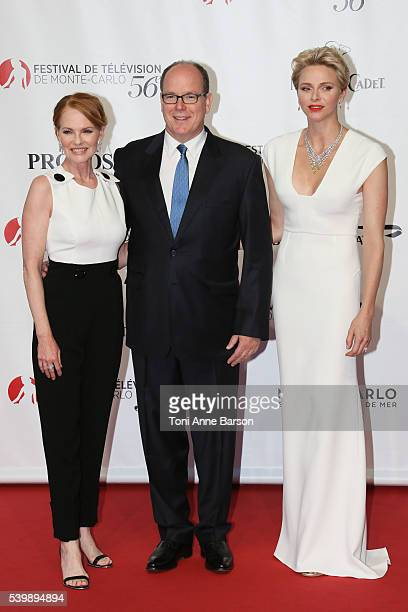 Marg Helgenberger HSH Prince Albert II of Monaco and HSH Princess Charlene pose at the 56th Monte Carlo Opening Ceremony at the Grimaldi Forum on...
