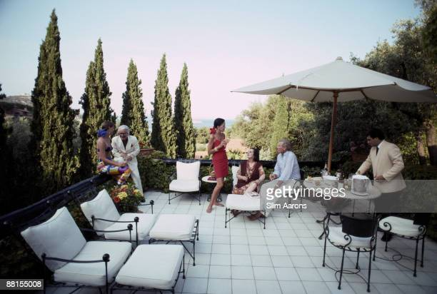 Margaret and Allan Scherer among the guests at the Scio family villa in Porto Ercole Italy July 1991