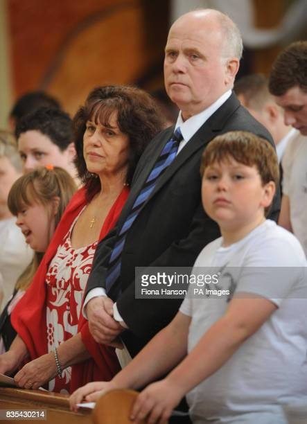 Margaret and Barry Mizen parents of murdered schoolboy Jimmy Mizen with son George during a memorial service to mark the first anniversary of Jimmy's...