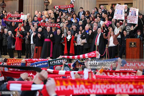 Margaret Aspinall and the Mayor of Liverpool Joe Anderson sing 'you'll never walk alone' along with housands of people outside Liverpool's Saint...
