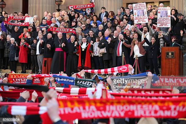Margaret Aspinall and the Mayor of Liverpool Joe Anderson sing 'you'll never walk alone' along with thousands of people outside Liverpool's Saint...