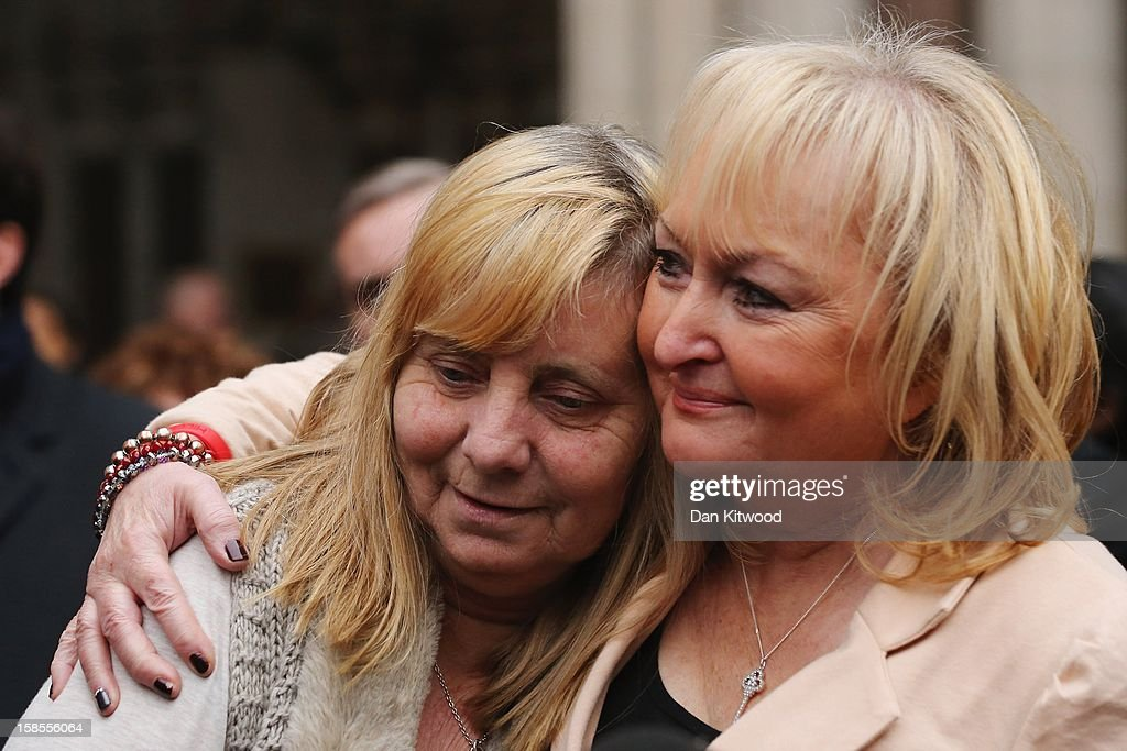 Margaret Aspinall, who lost her son, James and Jenni Hicks (R), who lost her two teenage daughters Sarah and Victoria, embrace as they gather with the families of the 96 football fans who lost their lives in the Hillsborough Disaster outside the High Court on December 19, 2012 in London, England. An application presented by the attorney general, Dominic Grieve to Lord Chief Justice, Lord Judge has resulted in the quashing of the original accidental death verdict and an order for fresh inquests. The Hillsborough disaster occurred during the FA Cup semi-final tie between Liverpool and Nottingham Forest football clubs in April 1989 at the Hillsborough Stadium in Sheffield, which resulted in the deaths of 96 football fans.