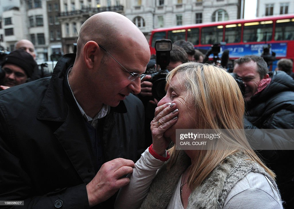 Margaret Aspinall (R), who lost her son James in the 1989 Hillsborough disaster, is comforted outside the High Court in central London on December 19, 2012, as she reacts after the High Court quashed the original accidental death verdicts returned on 96 Liverpool football fans who died in the tragedy. The request from the Attorney General to quash the original inquest verdicts follows the publication of a damning independent report in September which concluded that 41 of the 96 people who died would have had the 'potential to survive' if they had received medical treatment more quickly. Attorney General Dominic Grieve called for fresh inquests to be held. AFP PHOTO / CARL COURT