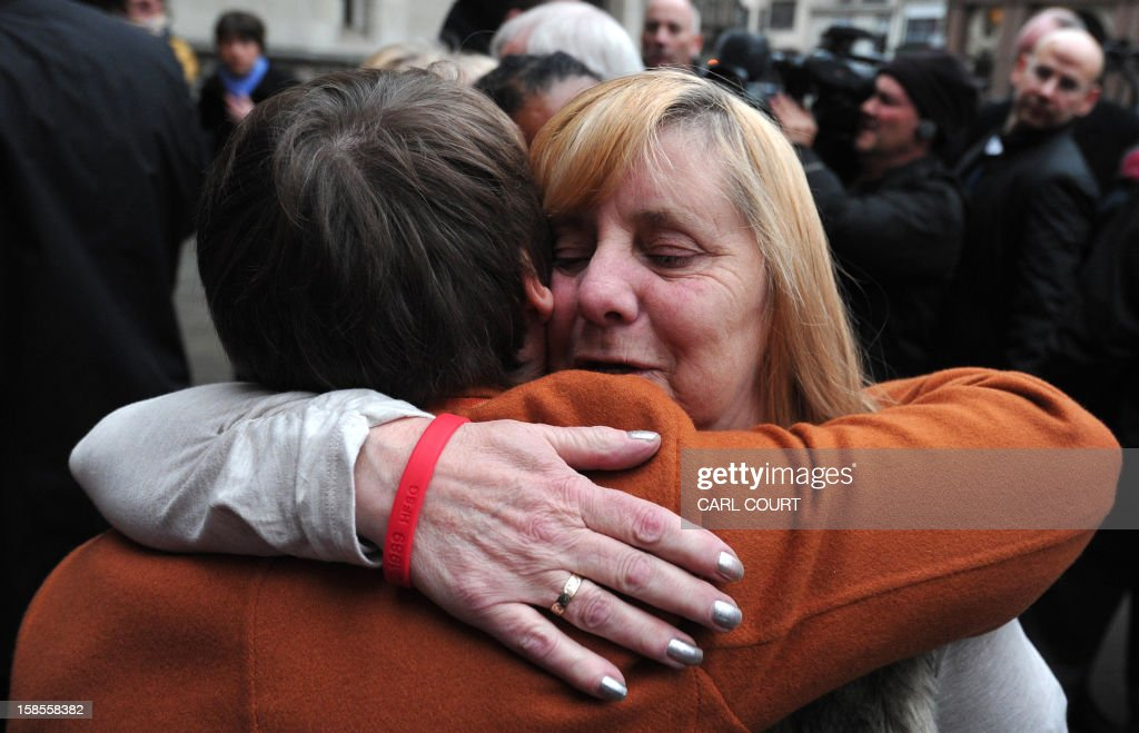 Margaret Aspinall (R), who lost her son James in the 1989 Hillsborough disaster, is comforted outside the High Court in central London on December 19, 2012, after the High Court quashed the original accidental death verdicts returned on 96 Liverpool football fans who died in the tragedy. The request from the Attorney General to quash the original inquest verdicts follows the publication of a damning independent report in September which concluded that 41 of the 96 people who died would have had the 'potential to survive' if they had received medical treatment more quickly. Attorney General Dominic Grieve called for fresh inquests to be held. The fatal crush was caused by huge overcrowding in a terrace at Hillsborough Stadium in the northern English city of Sheffield prior to an FA Cup semi-final between Liverpool and Nottingham Forest in 1989.