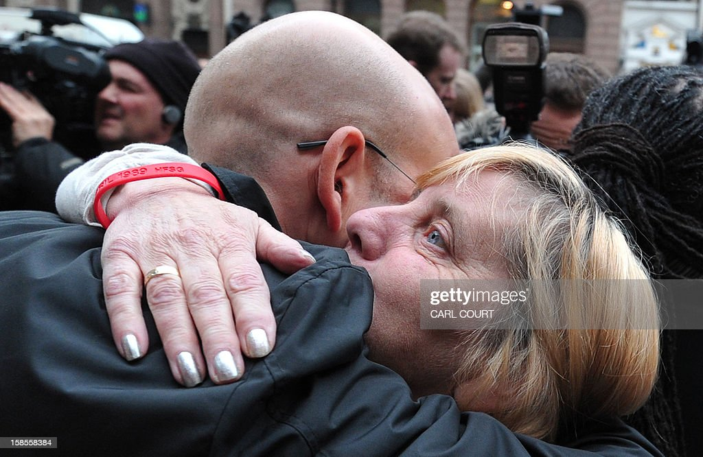 Margaret Aspinall (R), who lost her son James in the 1989 Hillsborough disaster, is comforted outside the High Court in central London on December 19, 2012, after the High Court quashed the original accidental death verdicts returned on 96 Liverpool football fans who died in the tragedy. The request from the Attorney General to quash the original inquest verdicts follows the publication of a damning independent report in September which concluded that 41 of the 96 people who died would have had the 'potential to survive' if they had received medical treatment more quickly. Attorney General Dominic Grieve called for fresh inquests to be held. The fatal crush was caused by huge overcrowding in a terrace at Hillsborough Stadium in the northern English city of Sheffield prior to an FA Cup semi-final between Liverpool and Nottingham Forest in 1989. AFP PHOTO / CARL COURT