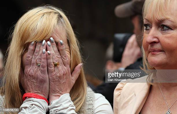 Margaret Aspinall who lost her son James reacts alongside Jenni Hicks who lost her two teenage daughters Sarah and Victoria as they gather with the...