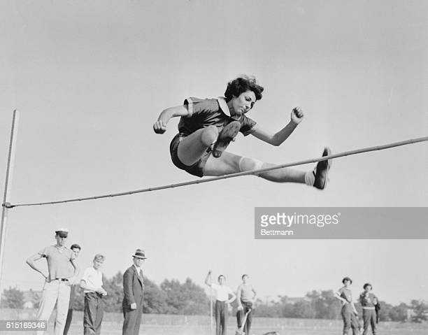 Margaret Bergmann European record holder five feet three inches and German member of the Park Central AC is pictured as she soared over the high jump...