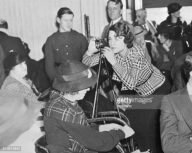 Margaret BourkeWhite the foremost woman photographer is pictured here as she obtained pictures in the Hunterdon County Courthouse in Flemington New...