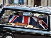 Margaret Charlesworth the mother of Private Anthony Frampton sits in the hearse beside his coffin as the funeral cortege leaves Huddersfield Parish...