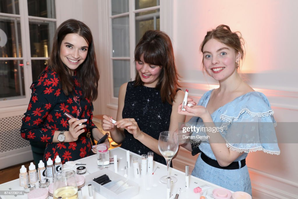 Margaret Clunie (L), Nell Hudson (R) and guest attend the Glossier UK launch party on November 14, 2017 in London, England.