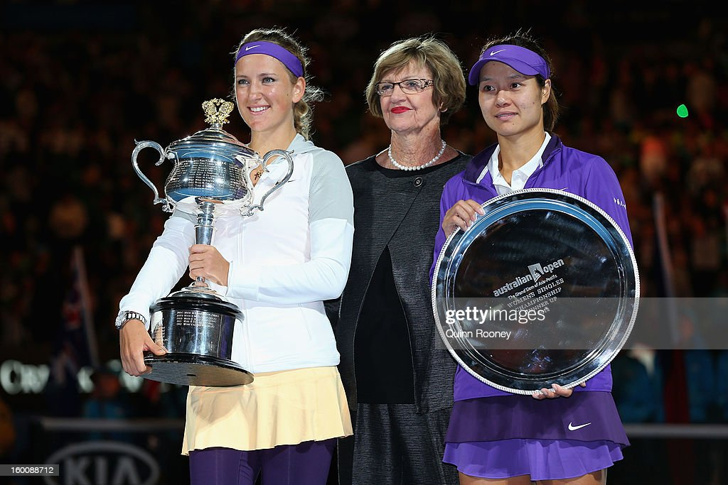 Margaret Court poses with Victoria Azarenka of Belarus with the Daphne Akhurst Memorial Cup and Na Li of China with the runners up trophy after their...
