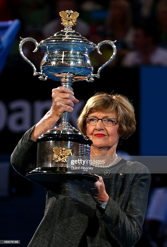Margaret Court stands with the Daphne Akhurst Memorial Cup to be presented to the winner of the women's final match between Victoria Azarenka of Belarus and Na Li of China during day thirteen of the 2013 Australian Open at Melbourne Park on January 26, 2013 in Melbourne, Australia.