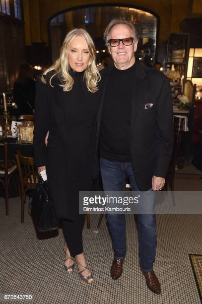 Margaret DeVogelaere and Peter Fonda attend the CHANEL Tribeca Film Festival Artists Dinner at Balthazar on April 24 2017 in New York City