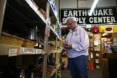 Margaret Harrington inspects a lantern while shopping for earthquake supplies at Earthquake Supply Center on August 27 2014 in San Rafael California...
