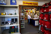 Margaret Harrington is helped by Marc Rich as she shops for earthquake supplies at Earthquake Supply Center on August 27 2014 in San Rafael...