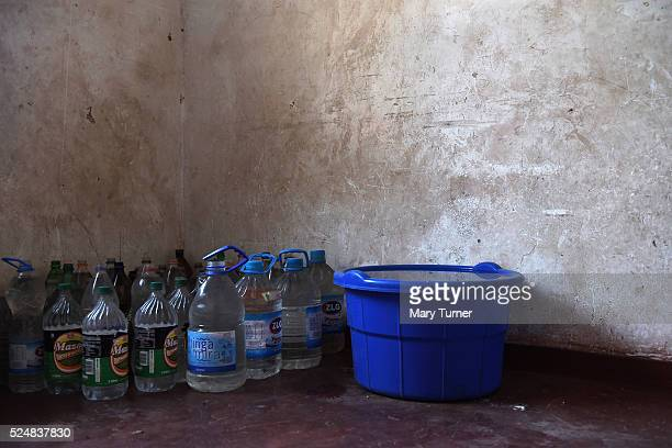 Margaret Jack and her family stockpile water to get them through the week as there no running water available except at the weekend in their town of...