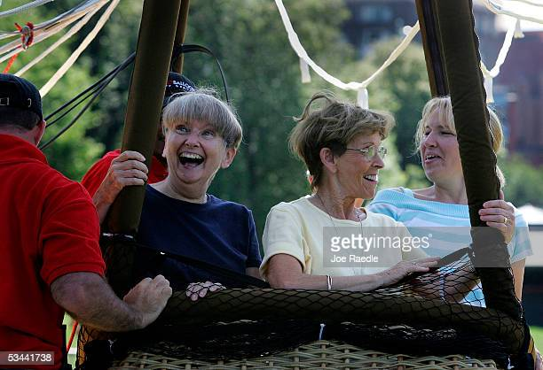 Margaret McLaughlin Nancy Farrell and Linda McLaughlin prepare to take off in the AeroBalloon USA's giant helium balloon on the grounds of the Boston...