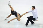 Margaret Purdy and Michael Marinaro of Canada perform their routine at the Pairs Free Skating event during the Four Continents Figure Skating...