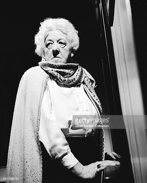 Margaret Rutherford British actress with a cape draped over her shoulders over a white blouse circa 1950