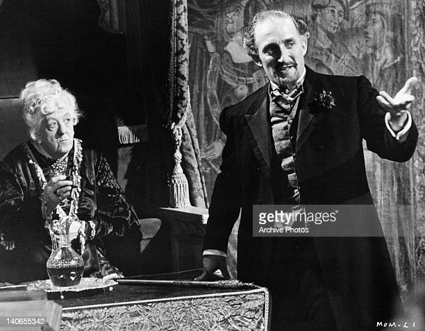 Margaret Rutherford watching Ron Moody pointing something out in a scene from the film 'The Mouse On The Mouse' 1963