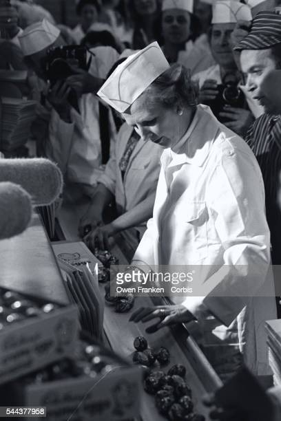 Margaret Thatcher dressed in a hygienic white uniform inspects chocolate eggs at the Cadbury Chocolate Factory during a 1979 campaign stop Thatcher...