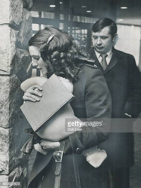 Margaret Trudeau holds baby Justin and a book as she returns to the Inn on the Park at Eglinton Ave E and Leslie St She walked to the elevators with...