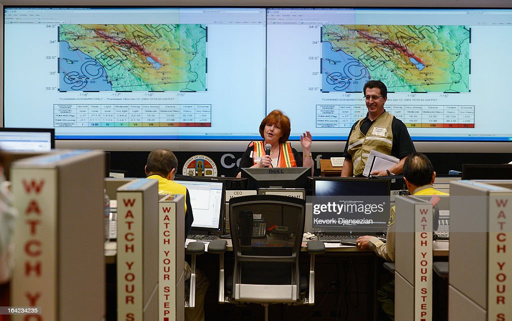 Margaret Vinci (L), manager of Office of Earthquake Programs and Seismological Laboratory at California Institute of Technology, speaks during a functional exercise simulating a magnitude 7.0 aftershock following a simulated 7.8 magnitude earthquake at the Los Angeles County Emergency Operations Center (CEOC) hosted by The County of Los Angeles Office of Emergency Management on March 21, 2013 in Los Angeles, California. The training exercise featured the California Integrated Seismic Network's Earthquake Ready Warning Demonstration System, which included 88 cities, 137 unincorporated communities, 200 schools and several nonprofit organizations.