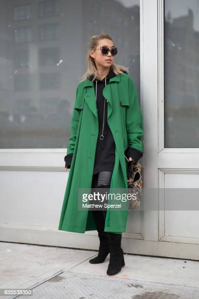 Margaret Zhang is seen attending Michael Kors during New York Fashion Week wearing a green coat on February 15 2017 in New York City