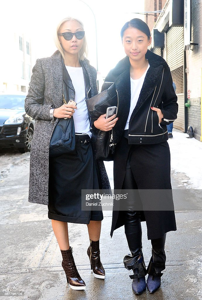 Margaret Zhang (R) is seen outside the Cushnie et Ochs show on February 7, 2014 in New York City.