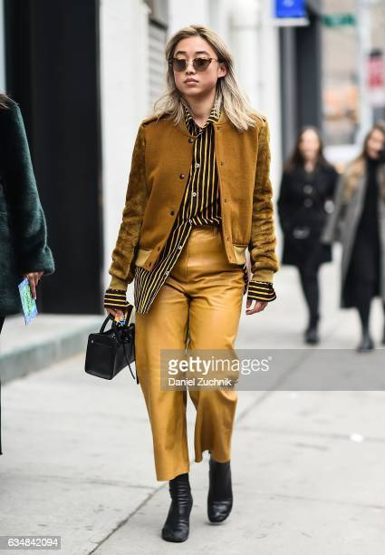 Margaret Zhang is seen wearing a mustard jacket and leather pants at the Tibi show during New York Fashion Week Women's Fall/Winter 2017 on February...