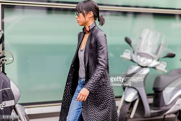 Margaret Zhang is wearing a black leather coat grey shirt blue denim jeans seen outside Giorgio Armani during Milan Fashion Week Fall/Winter 2016/17...