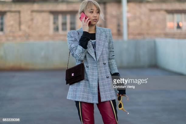 Margaret Zhang wearing a grey blazer red leather pants at day 2 during MercedesBenz Fashion Week Resort 18 Collections at Carriageworks on May 15...