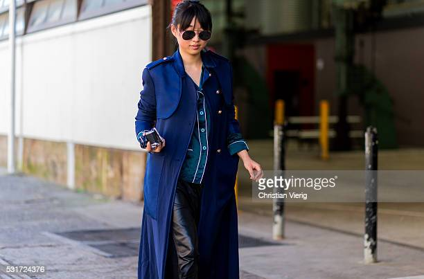 Margaret Zhang wearing a long navy trench coat black leather pants outside Georgia Alice at MercedesBenz Fashion Week Resort 17 Collections at...