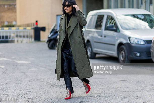 Margaret Zhang wearing an olive trench coat seen outside Christopher Kane during London Fashion Week Autumn/Winter 2016/17 on February 22 2016 in...
