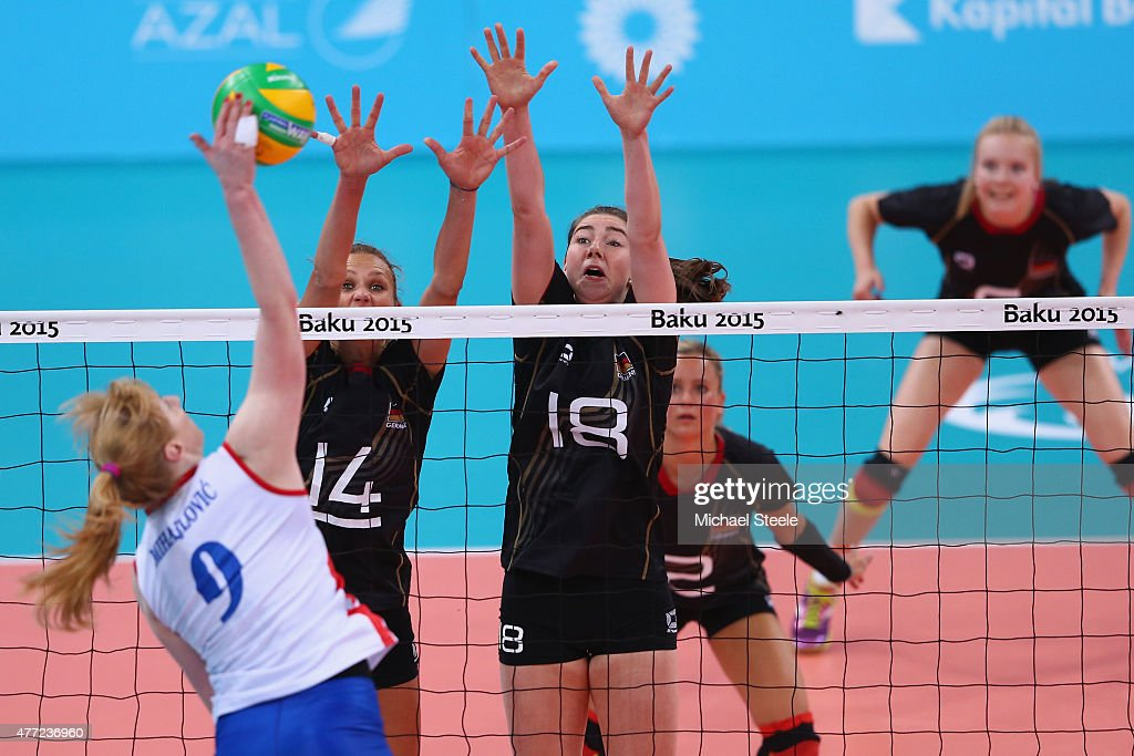 Margareta Kozuch (#14) and Wiebke Silge (#18) of Germany block a spike from <a gi-track='captionPersonalityLinkClicked' href=/galleries/search?phrase=Brankica+Mihajlovic&family=editorial&specificpeople=9605568 ng-click='$event.stopPropagation()'>Brankica Mihajlovic</a> (L) of Serbia during the Women's Volleyball Preliminary Pool B match between Germany and Serbia during day three of the Baku 2015 European Games at Crystal Hall on June 15, 2015 in Baku, Azerbaijan.