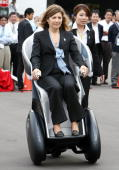 Margarida Sousa Uva wife of European Commission President Jose Manuel Barroso tries out Toyota Motor Corporation's Personal Mobility iREAL during a...