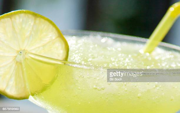 Margarita extreme closeup with lime slice and straw