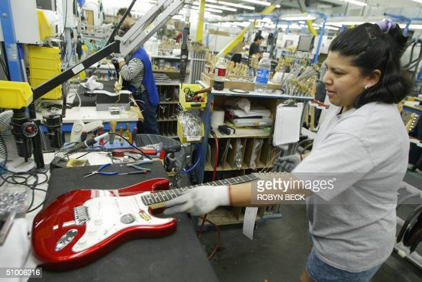Margarita Fernandez assembles a Fender Stratocaster guitar at the Fender manufacturing facility in Corona California 28 June 2004 The sainted...