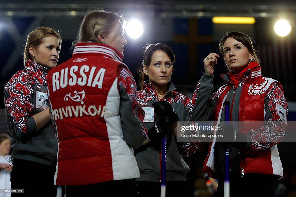 Margarita Fomina, Luidmila Privivkova, Ekaterina Galkina and Anna Sidorova of Russia speak between ends in the match between Japan and Russia on Day 5 of the Titlis Glacier Mountain World Women's Curling Championship at the Volvo Sports Centre on March 20, 2013 in Riga, Latvia.